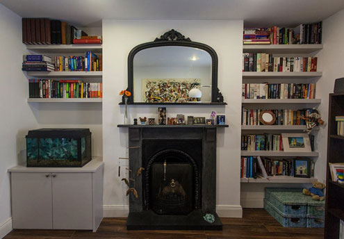 low-storage-unit-and-counter-for-fish-tank-with-floating-shelves-front ...